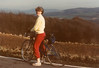 MaryAnne bicycling near sheep - (December 24, 1987 / Römerstraße, Gimsbach, Rheinland-Pfalz, West Germany) -- MaryAnne