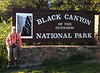 June 6, 2014 - (Black Canyon of the Gunnison National Park [entrance] / Montrose, Montrose County, Colorado) -- MaryAnne with signage